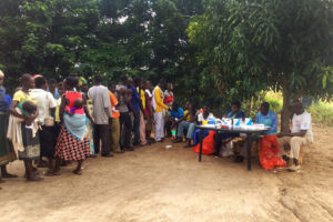 Community members queue to receive medical support during the health outreach day from Anaka Hospital and Amatheon Agri Uganda